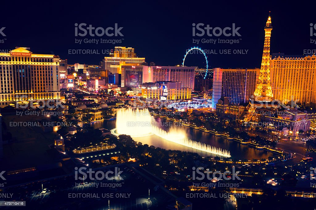 Las Vegas strip at night with Bellagio Fountain. stock photo