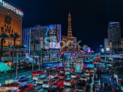 The Las Vegas strip at night with cars lined up on the road