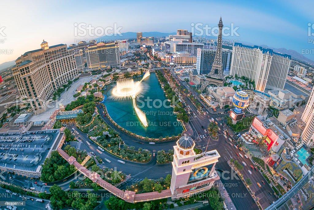 Las Vegas Strip with Bellagio Fountain Show at Sunset stock photo