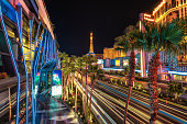 Las Vegas, USA  - July 12, 2014: Night illumination palm trees and Casino on Las Vegas Strip, Nevada,