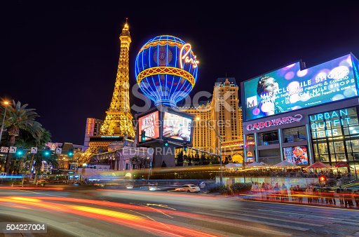 Las Vegas, USA - March 26, 2015: Night illumination on Las Vegas Strip, Nevada. Paris Las Vegas is a hotel and casino located on the Las Vegas Strip in Paradise, Nevada. As its name suggests, its theme is the city of Paris, France; it includes a half scale, 541-foot tall replica of the Eiffel Tower.