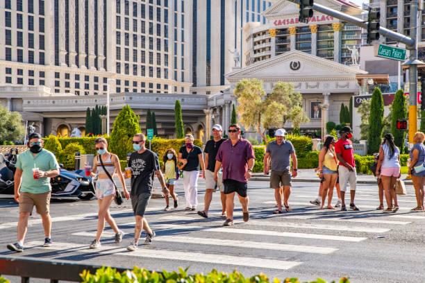 Las Vegas visitors with mask  under Corona Pandemic stock photo