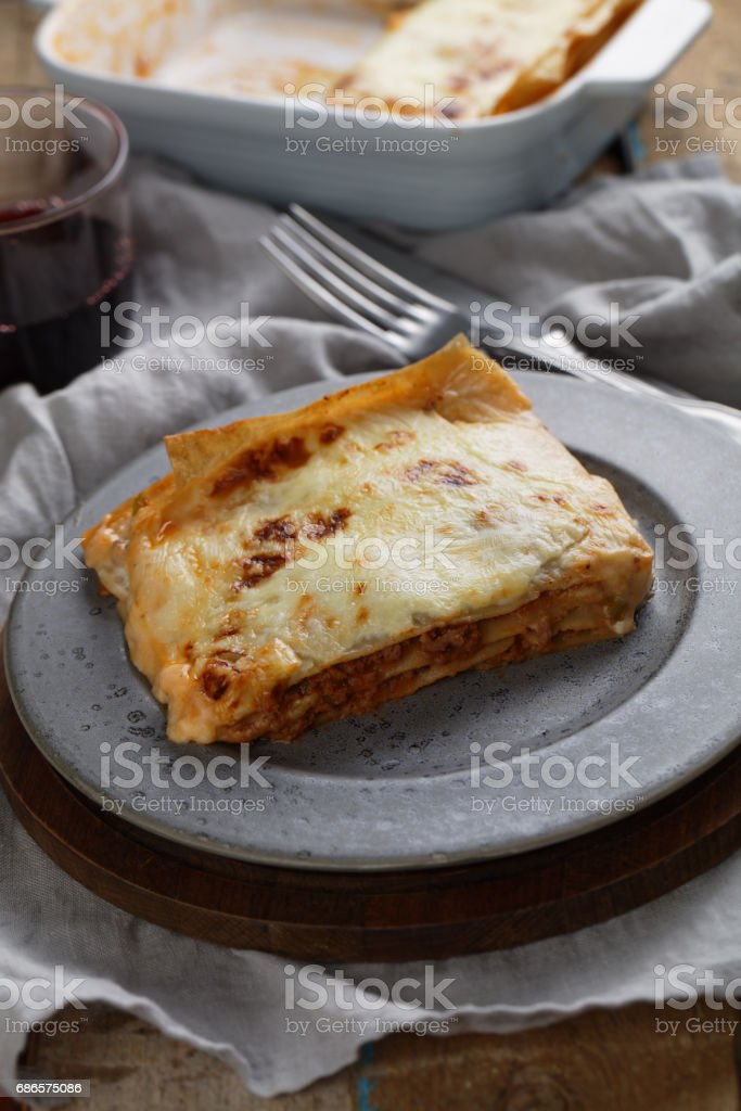 Lasagna Bolognese on a rustic table royalty free stockfoto