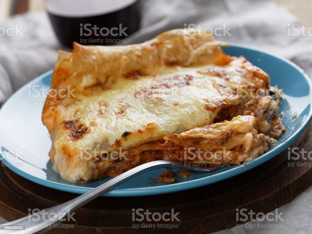 Lasagna Bolognese on a rustic table royalty-free stock photo