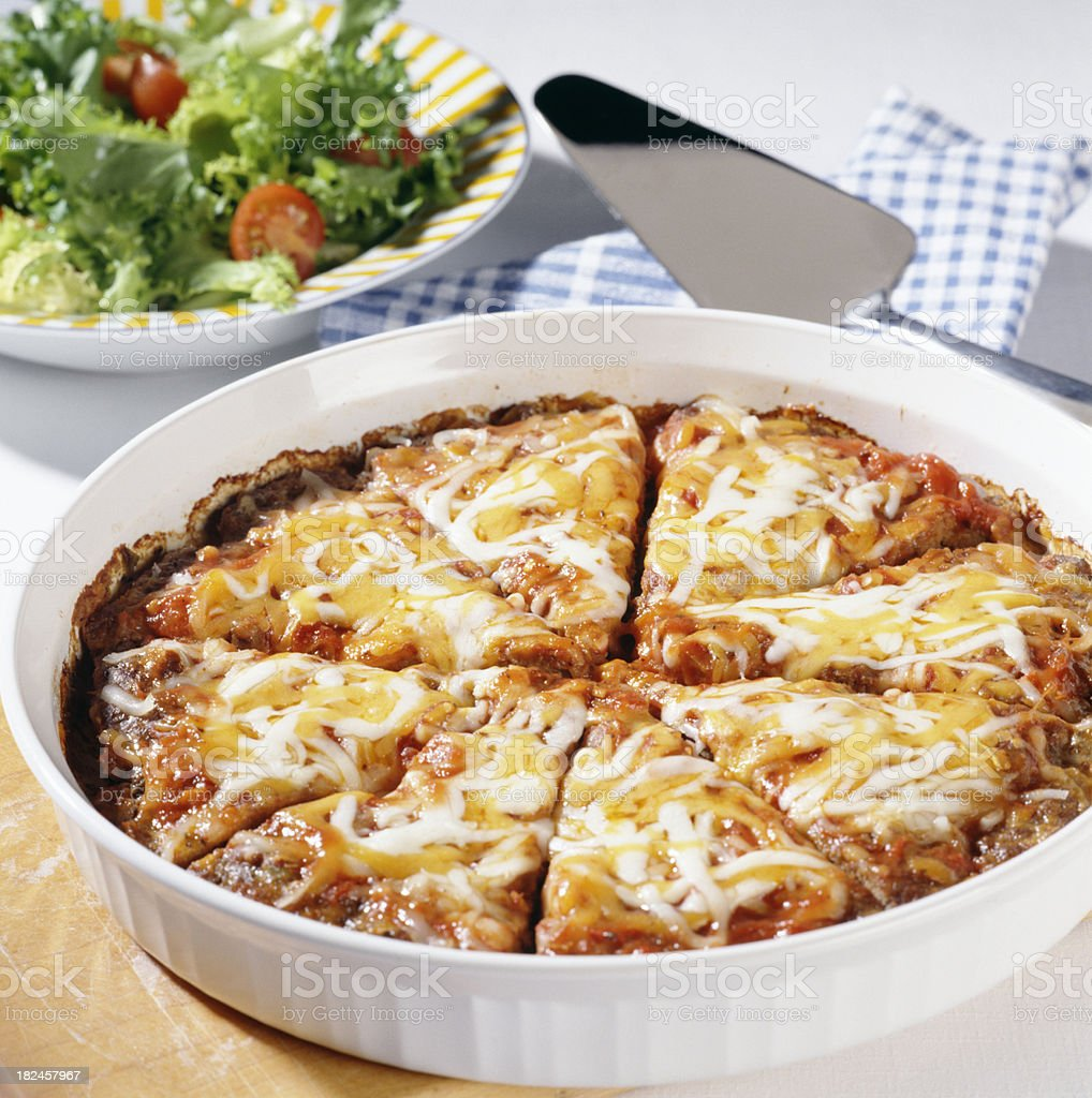 Lasagna in round casserole dish royalty-free stock photo