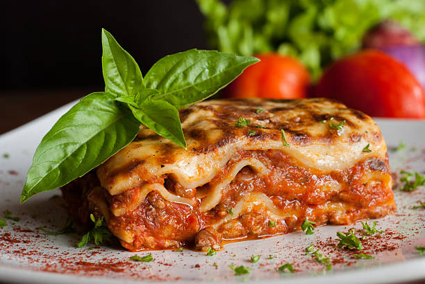 Lasagna on a square white plate stock photo