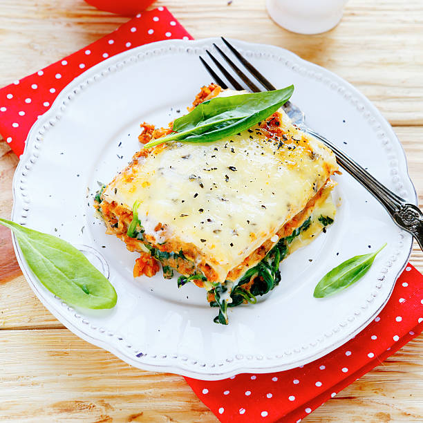 lasagna with spinach and mushroom stuffing stock photo