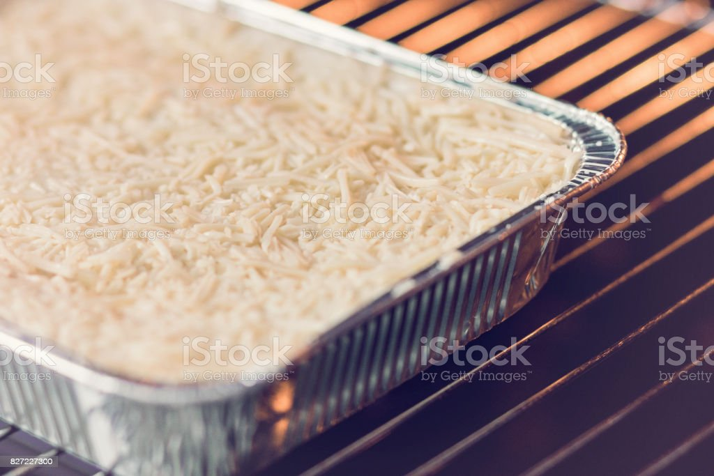 Lasagne Bolognese in disposable foil dish stock photo