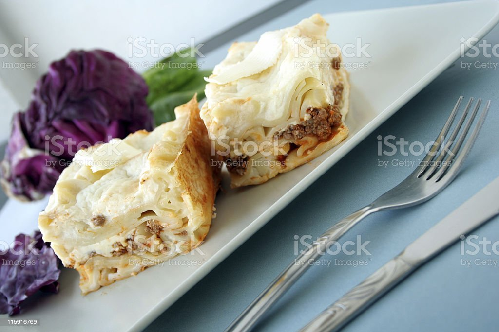 Lasagne on plate with vegetables royalty-free stock photo