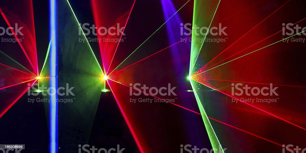 Laser beams in nightclub stock photo
