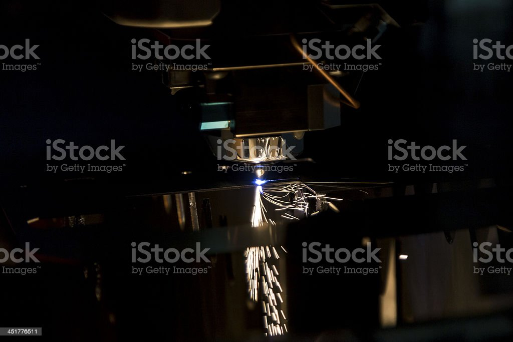 Laser cutting metal with sparks stock photo