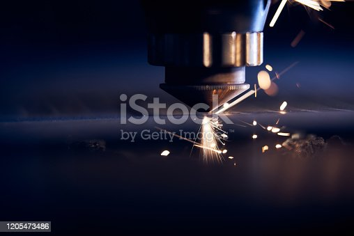 CNC Laser cutting of metal close up, modern industrial technology. Small depth of field.