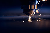 istock CNC Laser cutting of metal close up, modern industrial technology. Small depth of field 1205473486