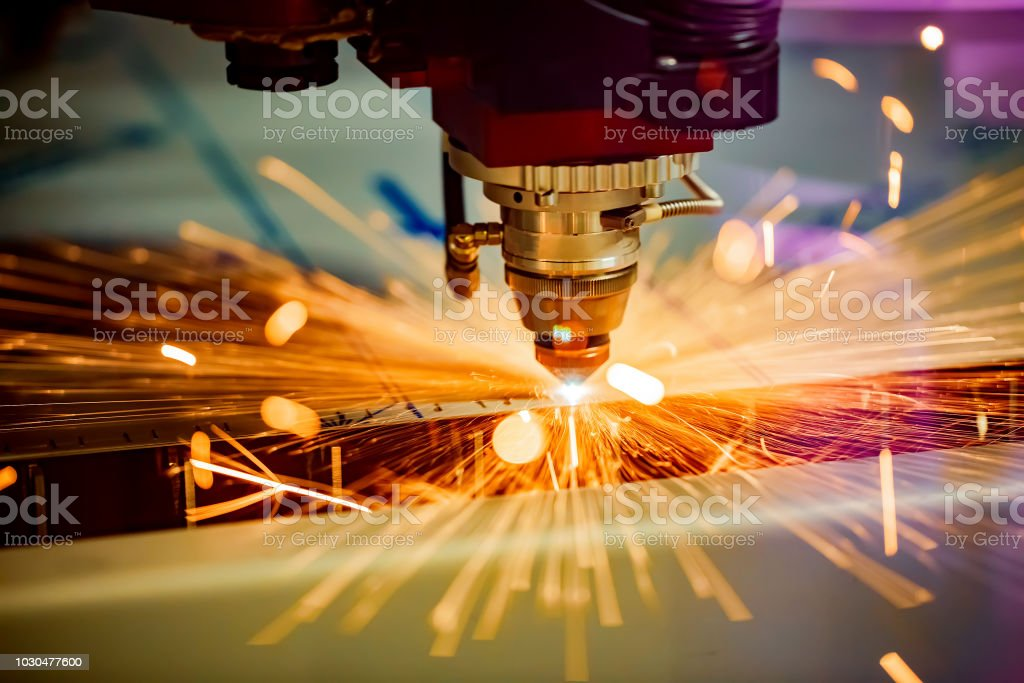 CNC Laser cutting of metal, modern industrial technology. - Royalty-free Accuracy Stock Photo