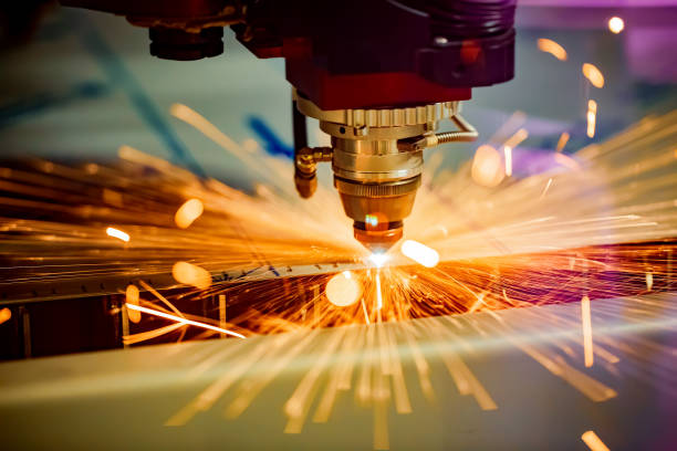 CNC Laser cutting of metal, modern industrial technology. CNC Laser cutting of metal, modern industrial technology. Small depth of field. Warning - authentic shooting in challenging conditions. manufacturing stock pictures, royalty-free photos & images