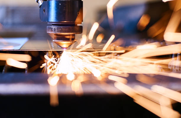 CNC Laser cutting of metal, modern industrial technology. Small depth of field. CNC Laser cutting of metal with sparks, modern industrial technology. Small depth of field. sheet metal stock pictures, royalty-free photos & images