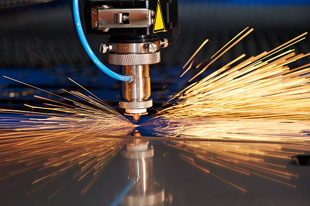 Laser cutting of metal sheet with sparks Industrial Laser cutting processing manufacture technology of flat sheet metal steel material with sparksClick on banner below to view more images in the sheet metal stock pictures, royalty-free photos & images