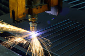 laser cutting torch machine in an industrial plant cuts sheet metal