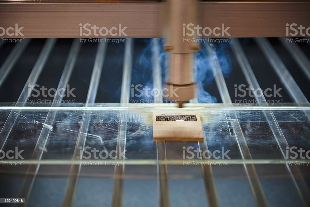 laser engraving machine cuting out text pattern royalty-free stock photo