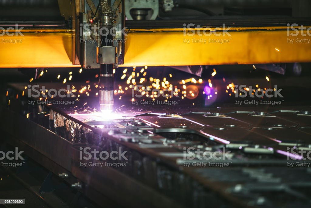 Laser equipment management and plant manufacturing metal structures stock photo