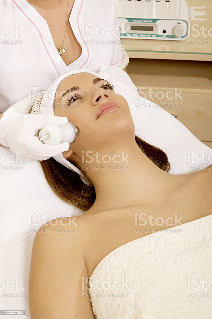 Laser hair removal in professional beauty studio royalty-free stock photo