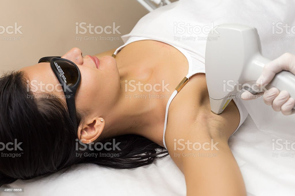 Laser hair removal in professional beauty studio stock photo