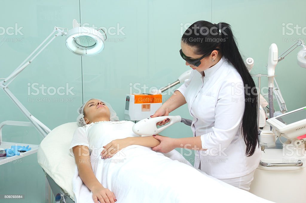 Laser hair removal on ladies hand stock photo