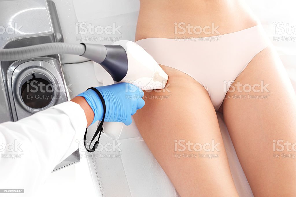 Laser hair removal thighs stock photo
