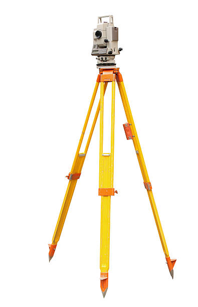 Laser level for surveying on a yellow and orange tripod