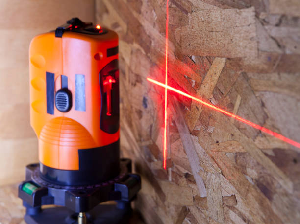 laser measurement level for construction works, small depth of sharpness, focus on a wall with a tag
