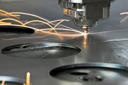 Laser metal cutting manufacturing tool in operation.