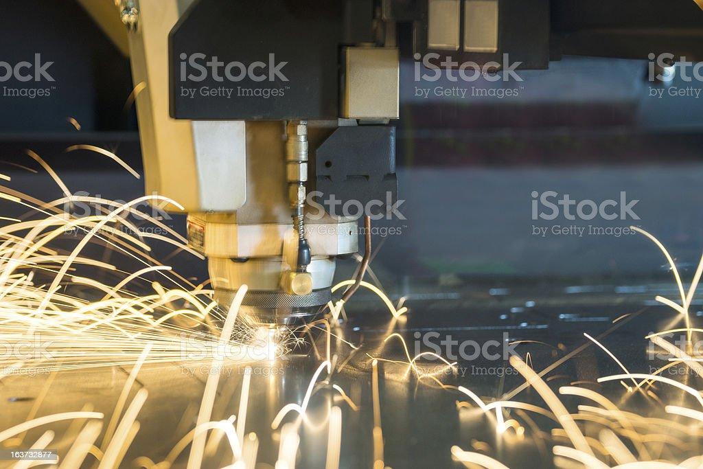Laser metal-cutting CNC manufacturing machine tool royalty-free stock photo