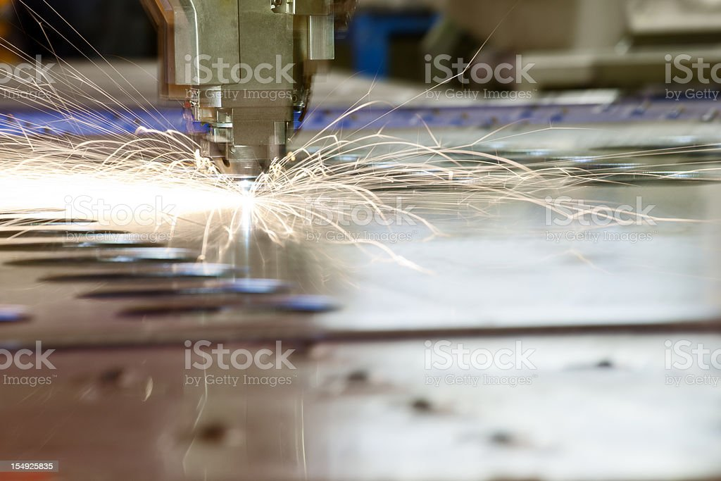 Laser metal-cutting CNC tool in operation stock photo