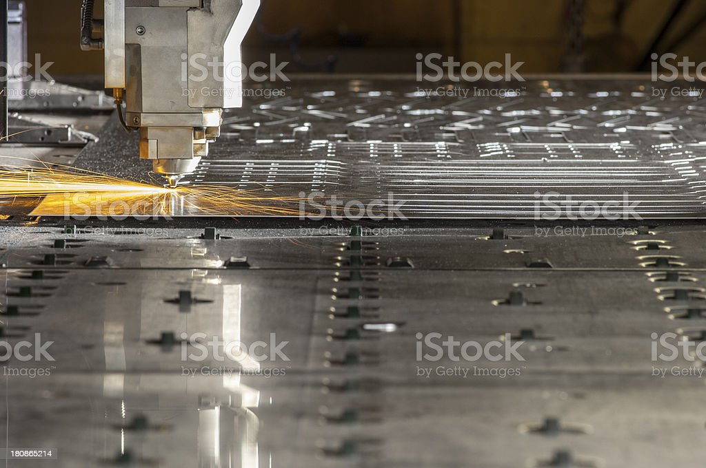 CNC, laser, metal-cutting tool in use. stock photo