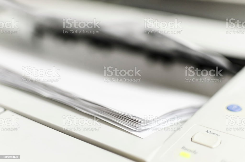 Laser Printer Printing Documents, Office machine stock photo