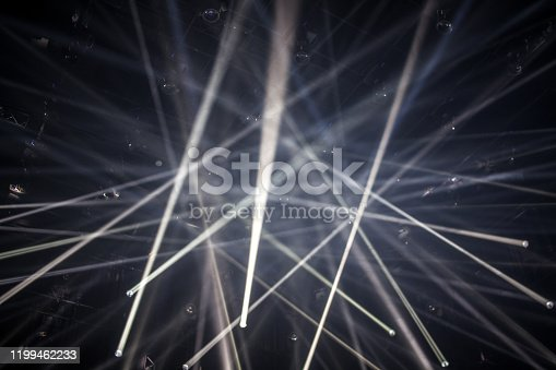 Laser show lights in front of black background