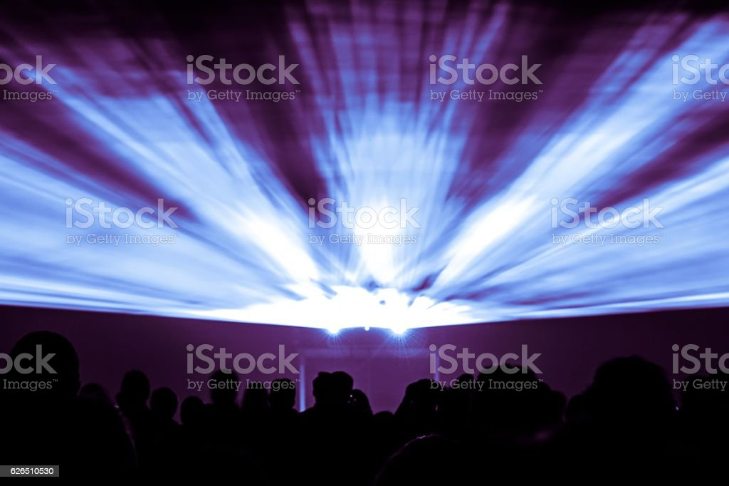 Laser show rays in nightlife party blue and purple colors stock photo