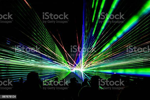 Laser show rays stream in disco party nightlife picture id597676124?b=1&k=6&m=597676124&s=612x612&h=2t7kcxebyy7jkrgznj9x3qlsyebijf5at7ldbsgmixa=