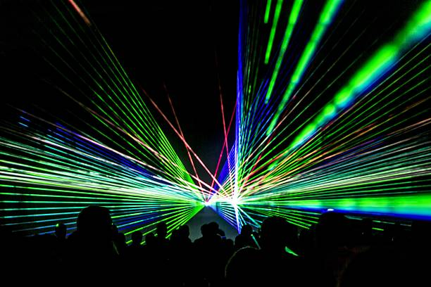 Laser show rays stream in disco party nightlife stock photo