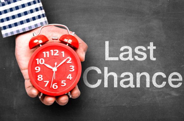 Last chance message on blackboard stock photo