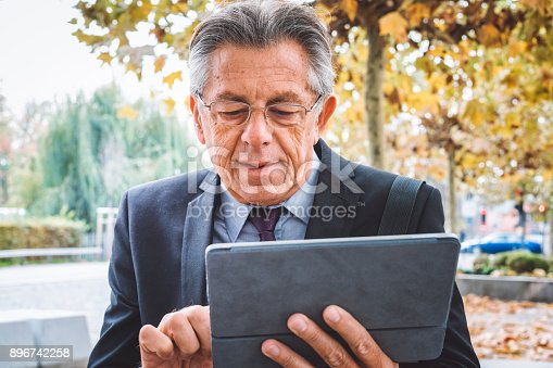 istock Last checking on the mail and I'm ready for the meeting 896742258
