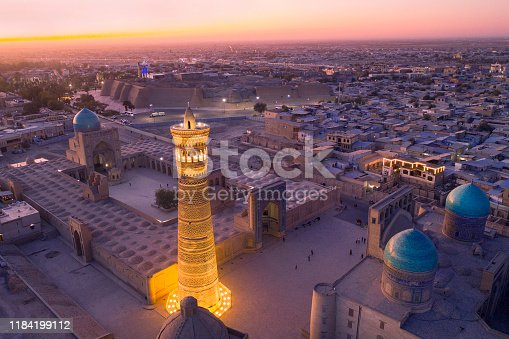 Panoramic view of the center of Bukhara around the Kalyan minaret (nearly 46 m hight and build in the early 12th century!) the Kaylan mosque (left in the background, 16th century) and the Mir-i Arab Madrassah (the two domes right, 1535–1536). The center of Bukhara (also calloed Buchara or Buxoro) is listed as UNESCO World Heritage Site. Bukhara was one of the most important oasis and place of caravanserais at the Great Silk Road.