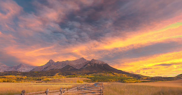 Last Dollar Ranch at Sunset Last Dollar Ranch at sunset with San Juan Mountains and Mt Sneffels in background. Last Dollar road, Ridgway, Colorado. san juan mountains stock pictures, royalty-free photos & images