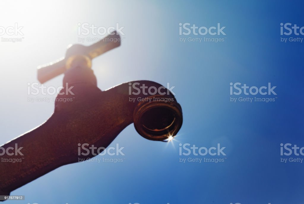Last drop of water symbolizes drought stock photo