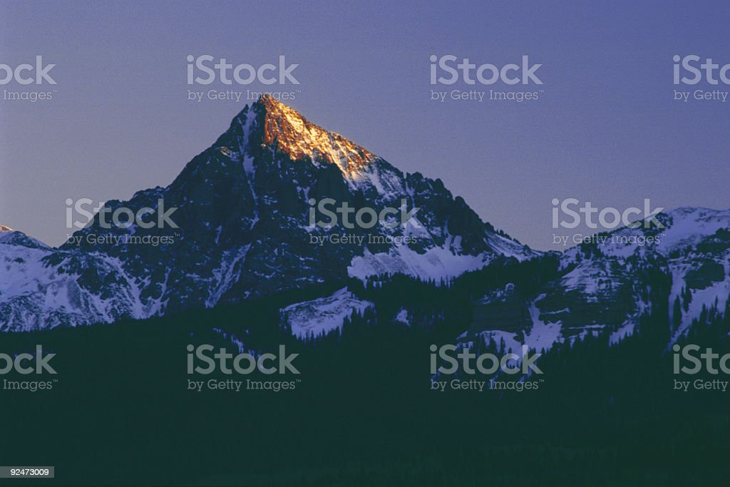 last light touches the west face of a colorado peak royalty-free stock photo