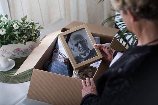 Last look on husband Woman is packing things of her dead husband dead stock pictures, royalty-free photos & images
