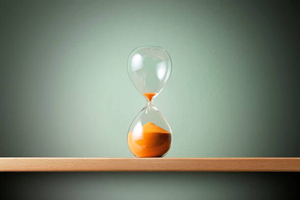 last minute. hourglass. - countdown stock photos and pictures