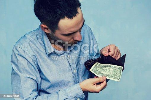 istock last one dollar money banknote in wallet, 994069798