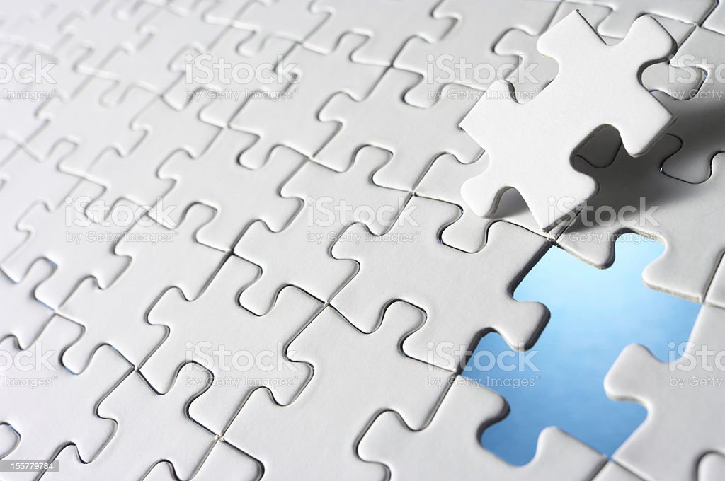 Last piece of jigsaw puzzle. royalty-free stock photo