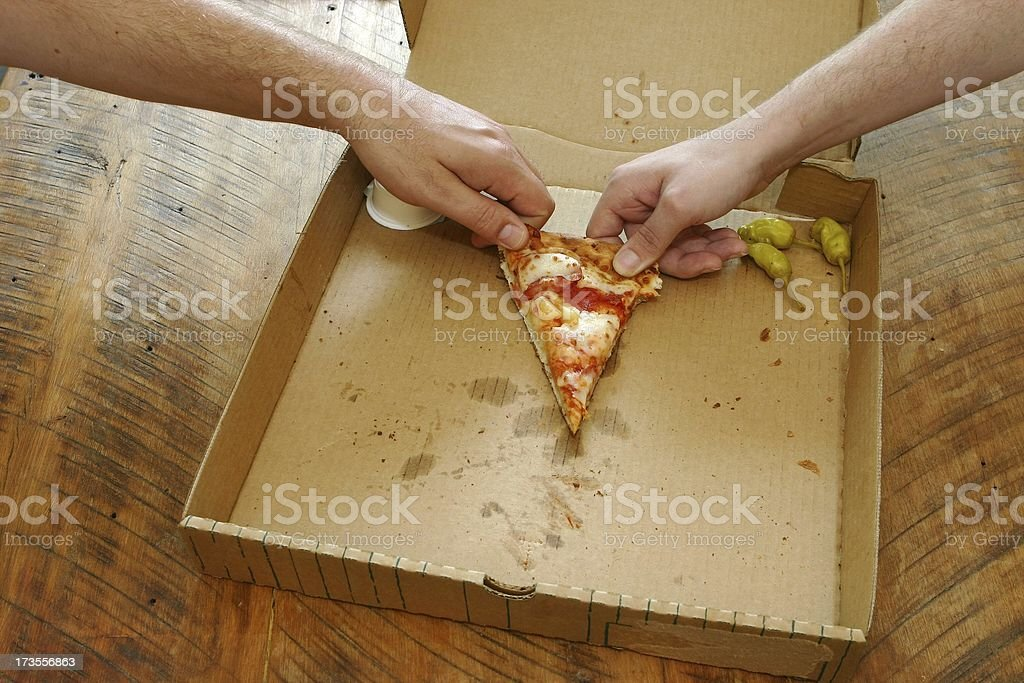 Last piece of pizza stock photo